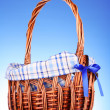 Wicker basket  on blue background — Stock Photo