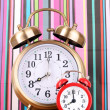 Two clocks    on  color background — Stock Photo