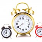 Three clocks on white background — Stock Photo