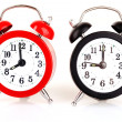 Two clocks    on white  background — Stock Photo