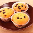 Royalty-Free Stock Photo: Muffins with raisins on wooden surface