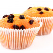 Muffin with raisins isolated on white — Stock Photo