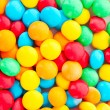 Background of multicolored candy coated chocolate sweets — Stock Photo