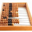 Wooden abacus isolated on a white background — Stock Photo