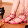 Young woman trying on new shoes in a store — Stock Photo