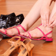 Young woman trying on new shoes in a store. — Stock Photo