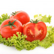 Red tomato  vegetables   on the green salad  background — Stock Photo #6661434