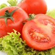 Red tomato vegetables on the green salad background — Stock Photo #6661436