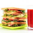 Royalty-Free Stock Photo: Huge sandwich and glass of tomato juice on white background