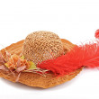 Hat with red feather and flowers - Stock Photo