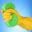 Stock Photo: Hand wearing working glove and holding big sponge