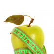 Green apple and tape measure close up — Stock Photo