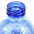 Plastic bottle with water drops on white background - Stockfoto