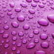 Violet water drops background with big and small drops — Stock Photo #6667577