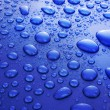 Stock Photo: Blue water drops background with big and small drops