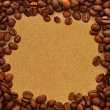 Coffee beans on old paper background — Stock Photo