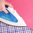 Stock Photo: Womhand ironing