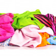 Big heap of colorful clothes isolated on white background — Stock Photo