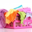 Bright clothes in a laundry basket on white background — Stock Photo