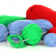 Knitting yarn and knitting needles on white — Stock Photo