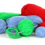 Knitting yarn and knitting needles on white — Stock Photo #6668804