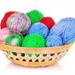 Balls of color knitting wool or yarn in basket on white — Stock Photo #6668817