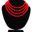 Red beads on black mannequin — Stock Photo