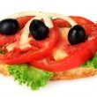 Tasty sandwich with tomatoes and olives isolated on white — Stock Photo