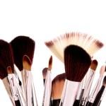 Cosmetic brushes on white — Stock Photo