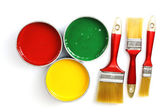 Open tin cans with paint and brushes — Stock Photo