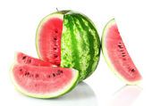 Ripe watermelon and slices — Stock Photo
