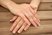 Woman hands with french manicure — Stock Photo