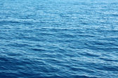 Blue water background surface with ripples — Stock Photo