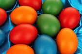 Colorful Easter Eggs on Textile background — Stock Photo