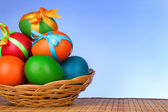 Easter eggs with bows isolated on white — Stock Photo