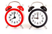 Two clocks on white background — Stockfoto