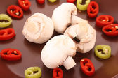 Closeup of champignons and chilly on the plate — Stock Photo