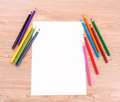 Paper and pencils on the wooden table — Stock Photo