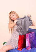 Girl in a retail store choosing clothes — Stock Photo