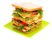 Huge sandwich and glass of tomato juice on white background — Stock Photo