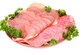 Slices of bacon on white background — Stock Photo