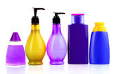 Bottles of health and beauty products on white background — Stock Photo