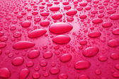 Red water drops background — Stock Photo
