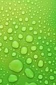 Green water drops background with big and small drops — Stock Photo