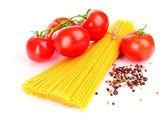 Pasta spaghetti with tomatoes on a white background — Stock Photo
