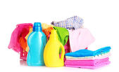 Bright clothes in a laundry basket and liquid laundry detergent — Stock Photo