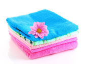 Stacked colorful towels on a white background — Stock Photo