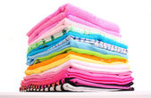 Pile of colorful clothes over white background — Stock Photo