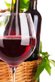 Nice glass of red wine against the basket — Stock Photo