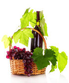 :red wine and grapes in a basket isolated on white — Stock Photo